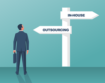 Businessman looking at a two-direction sign, deciding between facing digital transformation challenges via outsourcing or  doing it In-House.