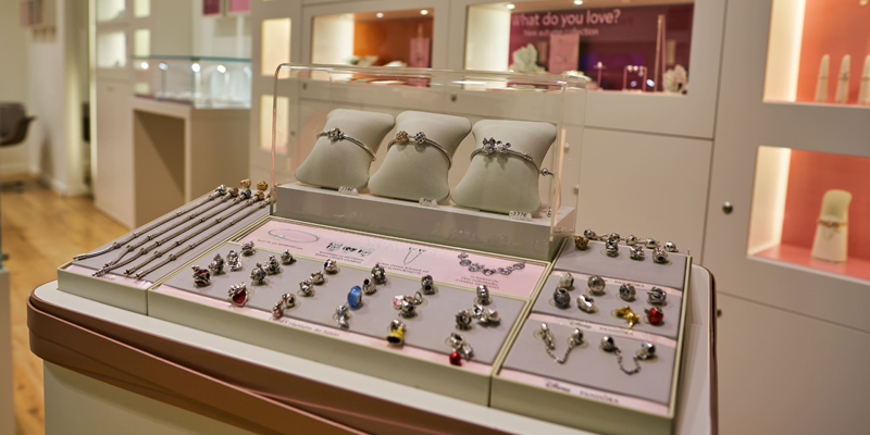 Jewelry display counter with different jewelries, representing the Retailer AP Outsourcing Growth