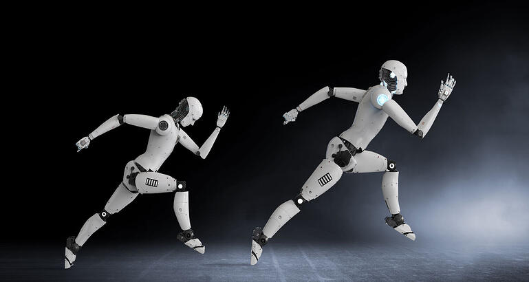 Two running humanoid robots representing a successful RPA implementation