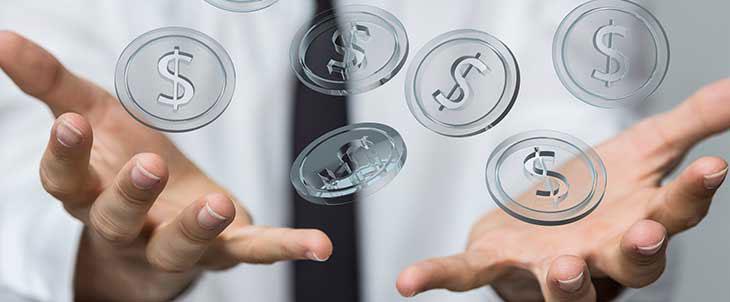 Man hands representing money savings using a consumption-based IT model
