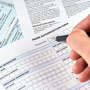 Authorization form being filled out before improved revenue access